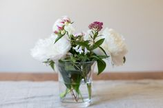 This foraged peony bouquet brings in spring and costs only $6 to make. We love it and think you will love making it too! (Click in for full tutorial)