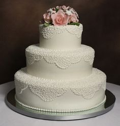 Traditional three-tiered, round wedding cake with lace doily design + light pink rose flower topper {Edda's Cake and Designs}
