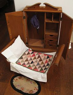 Primitives in miniature. Darling doll sized wardrobe, doll bed, quilt and linens, and a very sweet tiny hooked rug.