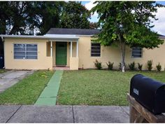 """6359 SW 44 St, South Miami, FL 33155 — An adorable 3 bedroom, 2 bath South Miami home, beautifully painted inside & outside. Generously sized living room + dining room. Kitchen has wood cabinetry, stainless steel refrigerator & dishwasher; kitchen opens to a large fenced backyard with mature avocado tree and detached storage shed. 2 br & 1 bath on the east side of home & the Master bedroom & bath (""""split"""") on West side of home (a lovely converted garage). Note: Tax Rolls…"""