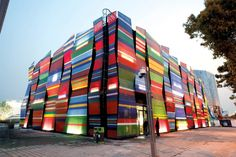 The brightly colored panels that clad the exterior of the Estonia Pavilion are dye sub printed fabric stretched over metal frames.