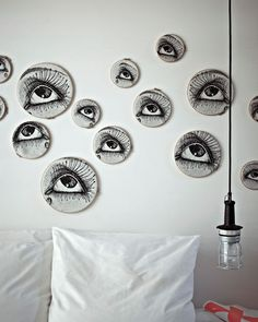 Manray's Eyes by Ina and Matt - at The Exchange Hotel in Amsterdam. The images look like they are stretched over embroidery hoops. Super cool!