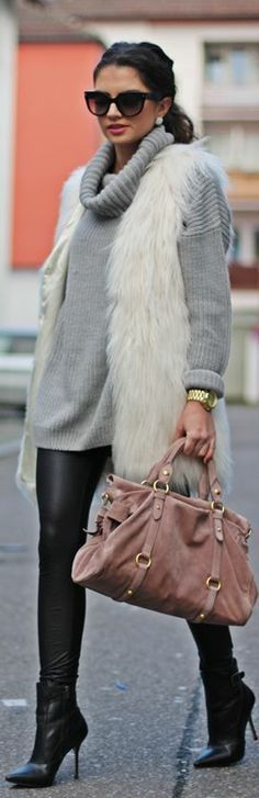 winter white fur vest, leather leggings and oversized grey sweater