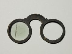 Eyeglasses, leather and glass, late 15th or 16th century, possibly southern German.