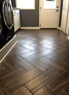 Mudroom flooring. Gray, wood grain tile in herringbone pattern.