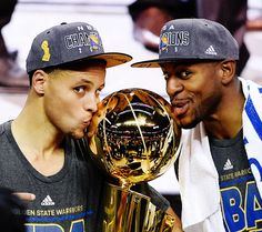 Stephen Curry and Andre Iguodala kiss the Larry O'Brien Trophy following the Golden State Warriors Game Six victory over the Cleveland Cavaliers in the NBA Finals -- June 16, 2015
