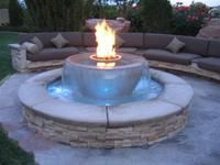 Custom fire & water fire pit with remote control from Fire By Design. teenager's dream. Press the remote from across the pool or patio, and VOILA! instant fire. ~ Fire By Design, 10624 S. Eastern Ave., Ste A826 Henderson, NV 89052.