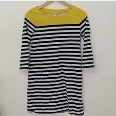 """T-Shirt Dress An awesome dress for spring! Yellow shoulder line with blue/white stripes throughout. Worn a couple times, like new  31.5"""" from shoulder to hem. Check old navy.com for sizing. Old Navy Dresses"""