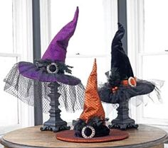 Witch Hat Table Centerpieces~ These look simple to make. Great idea to put them on candlestick holders.