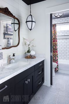 I love this Black and White bathroom remodel, vintage with a hint of industrial. The wall above the vanity is shiplapped and there is a marble countertop. The tub surround is a basic white subway tile with charcoal grout with a boarder of white penny tile White Subway Tile Bathroom, Black And White Tiles Bathroom, Small Bathroom, Subway Tiles, Condo Bathroom, Master Bathroom, Black And White Bathroom Floor, Charcoal Bathroom, Black Vanity Bathroom
