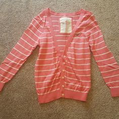 Cardigan Beautiful rose cardigan! Sz small from Hollister looks great dressed up or go casual. Perfect spring staple. No damage or signs of wear. Light weight Hollister Sweaters Cardigans