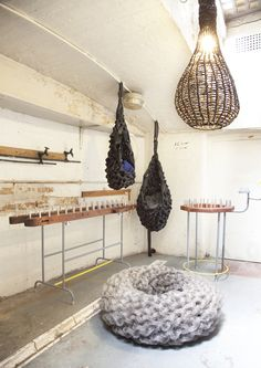 Jan Rose: The Knitting Craftsman. Pictured is outdoor ottoman/ seat knitted on custom-built loom from steel mesh tubular material; hanging structures made from webbed seatbelt material, et al.
