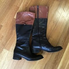 Etienne Aigner riding boots Etienne Aigner Knee high black boots with cognac brown top detailing. Worn a couple of times - in perfect condition. Barely any signs of wear! Etienne Aigner Shoes