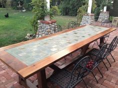 To make your patio more inviting, you can craft this Provence dining table with tiles fitted with the wooden frame to create a unique and durable outdoor table. The table looks ideal when placed on a brick patio under a wooden pergola. Grow plenty of flowers to enrich the ambiance with color and vibrancy.
