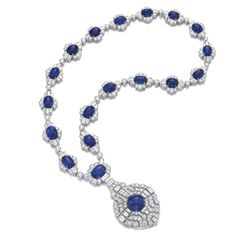 Sapphire and diamond necklace, Bulgari Suspending an openwork plaque set with a cabochon sapphire and brilliant-cut and baguette diamonds, on a similarly set necklace, length approximately 490mm, signed Bulgari, Italian assay mark.