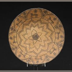 An Apache tray | With a series of concentric multi-pointed stars overseen by human figures and horses.