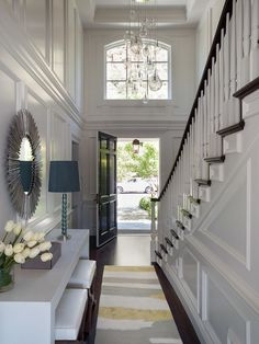 Green Couch - entrances/foyers - 2 story foyer, foyer, long foyer, bubbles chandelier, long foyer ideas, paneled walls, paneled foyer, wall ...
