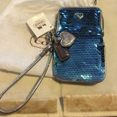 Authentic Coach Wristlet Coach Wristlet, beautiful blue sequence. New with tags, comes with storage bag. Coach Bags Clutches & Wristlets
