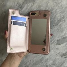 This cute rose gold mirror wallet phone case card holder for iPhone is beautiful and durable! Hold all your credit cards, cash and drivers license easily in this stylish phone case mobile device fashion accessory. This must-have functional smartphone wallet is perfect for a girl night out. Leave your bulky purse at home and keep all your essentials in one place. Luxury gorgeous & protective phone cases. Shop now at Cases A La Mode! Iphone Wallet Case, Iphone Cases, Girly Phone Cases, Phone Covers, Gifts For Techies, Portable Phone Charger, T Mobile Phones, Phone Gadgets, Tech Gadgets
