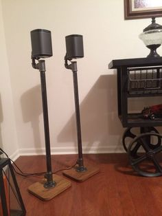 Industrial pipe speaker stands for surround sound systems. Only basic assembly will be required in order to make shipping easier. Most of the speaker wire can be easily hidden… Surround Sound Speaker Stands, Surround Speakers, Surround Sound Systems, Sonos Speakers, Diy Speakers, Speaker Wire, Sonos Speaker Stand, Speaker Table, Industrial Pipe