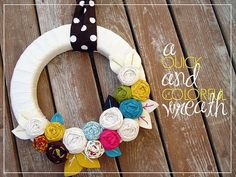 love this spring fabric/yarn wreath