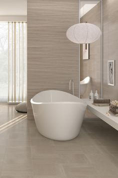 The Arabia range of neutral tiles add an elegant feel to kitchens and bathrooms, while the textured decor tiles are perfect for creating a stunning feature wall #bathroomtiles #ceramictiles #porcelaintiles #decortiles
