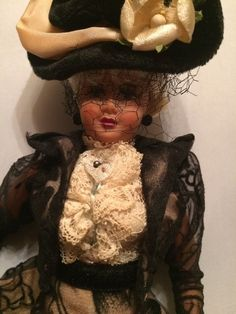 This is moving joints doll that is made of hard plastic. This doll was rescued from a Brooklyn doll collector estate. I cannot find a maker on it, but I did not remove the doll's clothes. She has an ivory lace blouse and black colored jacket and skirt with ivory silk petticoats underlay. | eBay!
