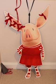 olivia the pig party - pin the ribbon on olivia game