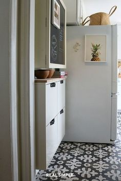5 of the Best IKEA Hacks for Organizing Small Spaces | Brooke at Nesting with Grace created a compact command station in her home with IKEA home decor like the STALL show cabinet and leather handles. It can hold computers, keys, and even cat food without taking up valuable kitchen space. #decorideas #homedecor #decorinspiration #realsimple #smallspaceideas #apartmentideas