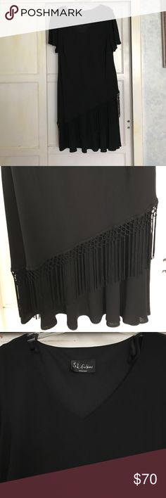 Black dress, perfect for a cocktail party! Black dress, with nice fringe on the bottom. Dresses