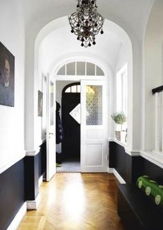 Marcus Design: black on bottom, black chandelier, & black door in background pulls it all together - love this look.