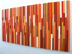 Did you know?........ Some exciting news about this art piece!: One of these orange sculputres I recently made is being used on the new set of the Today Show on NBC!!   Modern Wood Wall Art Sculpture in shades of Orange  Made To Order  Size: 24x48  This wood sculpture is made from strips of wood and has been painted in shades of orange, apricots and tangerine with white, and metallic golds.  This would definitely make a dramatic statement on any wall space in your home!  If you would like a…