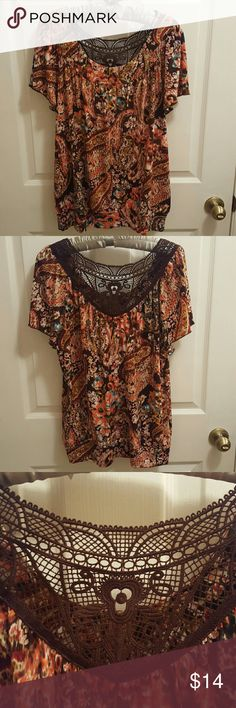 AGB colorful lace back shirt size L. Very nice Orange and brown colorful Shirt. With lace on the back stretch material. Was worn once it's in a great condition. AGB  Tops Blouses