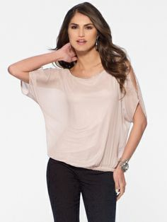 This top is all feminine elegance -- from the soft blush shade, slight sheen and slit shoulders to the floaty sleeves and subtle sparkle trim. Elbow length sleevesCut out shouldersElastic waist100% polyesterImportHand wash
