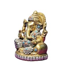 The addition of coral stones to this brass Ganpati idol doesn't fail to lighten up the festive spirit.