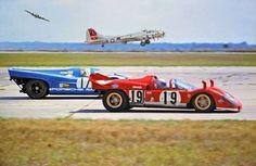 Porsche and Ferrari race cars with a B17