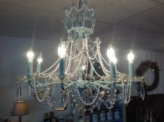 Broken down, stripped brass chandelier given new life -- Chalk Paint (R) decorative paint by Annie Sloan in Provence and Old White and tons of bling! Created by TLC Vintage Collection paint