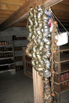Canning jar ring storage...  I think this uses bungie cords. I use old wire hangers.  Take a part, slide the ring on, then close the hanger back up.  And look at those canning jars in the back and the shelves.... ooooooh, I like!