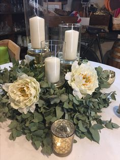 Candles and green to centerpiece