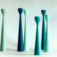 Simple and clean - turquoise, vintage, petrol, art-deco greens and royal blue Rolf™ candlesticks in beech wood, FREEMOVER.se Mid-Century Modern Design by Maria Lovisa Dahlberg. Celebrating ten years, 40 colors, teak and raw oak wood, three sizes. @FREEMOVER