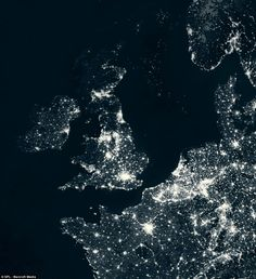 A satellite image of Britain and Europe at night showing the light show from space, with far greater uses of energy in the major cities..