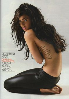 Megan Fox's tattoo: There once was a little girl who never knew love until a guy broke her heart.