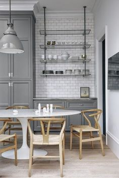 grey kitchen cabinets with white subway tiles and open kitchen shelving