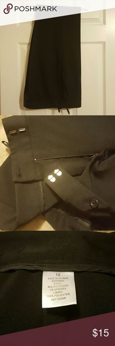 Black business/dress pants. Size 10. Unknown brand black business/dress pants. Size 10. Very nice pair of pants that I think the dry cleaners gave to me by mistake in place of one of my pairs of black pants. Excellent condition. I've upsized (ie gained some weight), so my gain is your gain.  Smoke free/cat free home. Pants Trousers