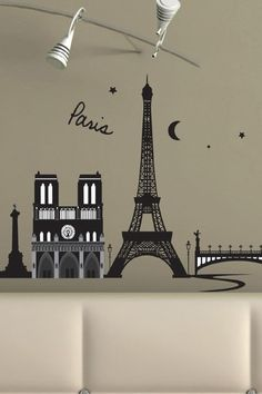 "The historic sites of Paris come to life in this romantically embellished decal set.  - Set can be arranged in any configuration  - Decals are repositionable and removable  - Once in place, press down firmly  - Images are shown to scale  - Low-tack adhesive backed vinyl  - Includes enough decals to decorate a wall area approximately 84"" x 28"", not all images shown are to scale  - Includes two decal sheets  - 20"" W x 28"" H x 1/8"" D each sheet"
