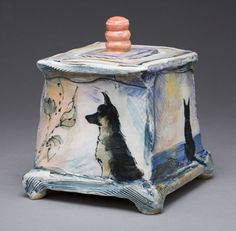 Laurie Shaman - Ceramic Artist I would like to make one of these to put Scrappy Dooooos ashes in it.