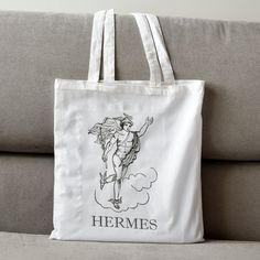 Items similar to Ancient Greek Hermes Tote Bag. Ideal As Book Bag, Student Bag, Shopping Bag. Cotton Made. on Etsy Hermes, Reusable Tote Bags, Trending Outfits, Unique Jewelry, Handmade Gifts, Etsy, Kid Craft Gifts, Craft Gifts, Costume Jewelry