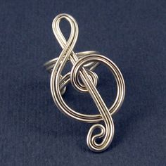 Treble Clef Ear Cuff and Ring  (maybe in sterling silver wire . . . right down my alley!