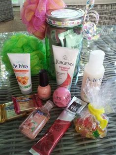 """I used a green Mason jar and filled it with facial scrub, mail polish, body wash, Eos lip balm, scented hand sanitizer, hand lotion, chocolate squares, Starbucks Refreshers drink mix packet, gummy bears in a cellophane bag tied with a hair elastic and then a scrubby attached to the outside if the jar. I made a tag that says """"spa in a jar"""" and glued it to the lid then tied a cute ribbon around it. It's a perfect go-to gift for teens, tweens, teachers, etc. I make a bunch and then i have them…"""