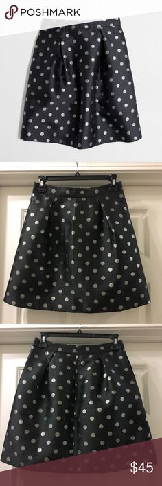 "NWT J. Crew Factory Silver Dot Jacquard Skirt Sz 0 J. Crew Factory Silver Dot Jacquard Skirt  Poly/metallic fibers. Sits above waist. 18 1/2"" long. Back zip. On-seam pockets. Lined. Dry clean. Online exclusive. Import. Item E4268.  Size: 0 NWT Black with Silver Dots J. Crew Factory Skirts"